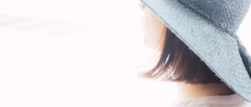 Girl in blue hat and white light
