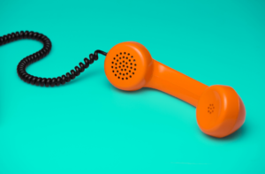 Orange helpline phone on a turquoise background